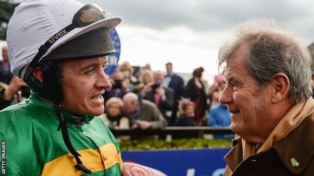 Jockey Barry Geraghty with boss JP McManus at Fairyhouse