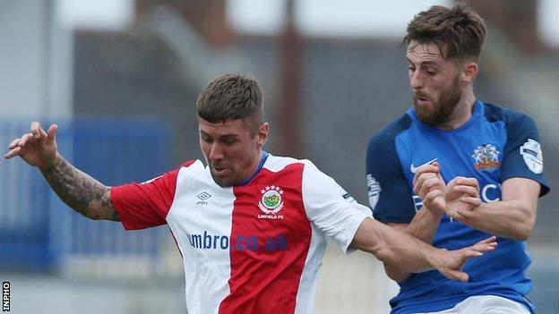 Daniel Kearns battles with Glenavon's Niall Grace on the opening day of the season at Mourneview Park