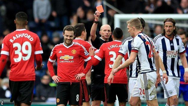Mata is shown a red card