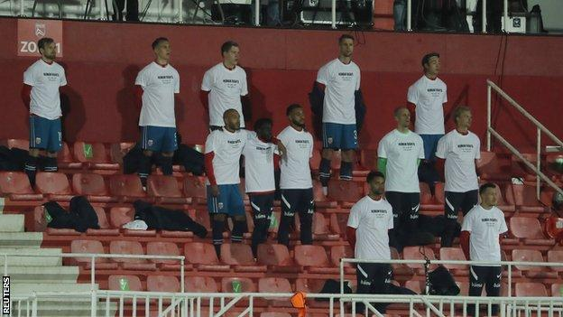 Norway players wear T-shirts saying 'Human rights on and off the pitch' prior to kick off against Gibraltar