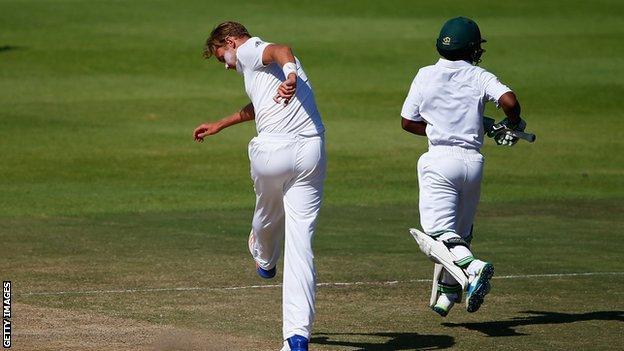 Stuart Broad kicks the pitch in Cape Town
