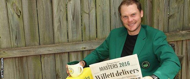New Masters champion Danny Willett reads a paper while relaxing in his Green Jacket