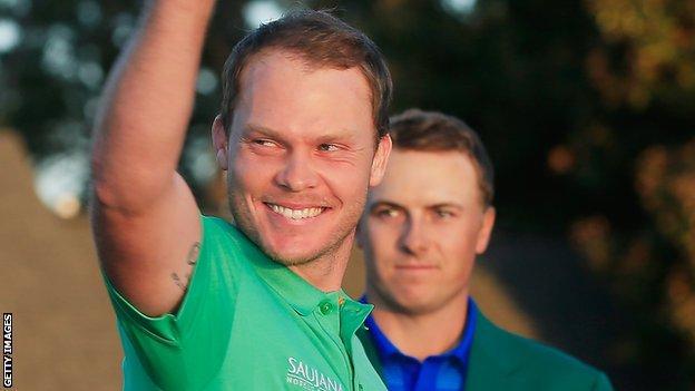 Jordan Spieth looks on as Danny Willett acknowldges the applause at Augusta