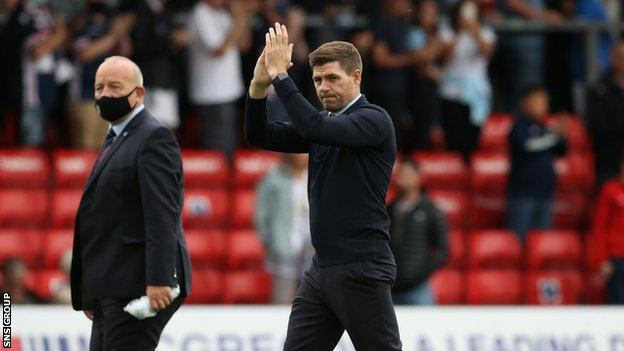 Steven Gerrard applauds Rangers supporters at Ross County on 22 August