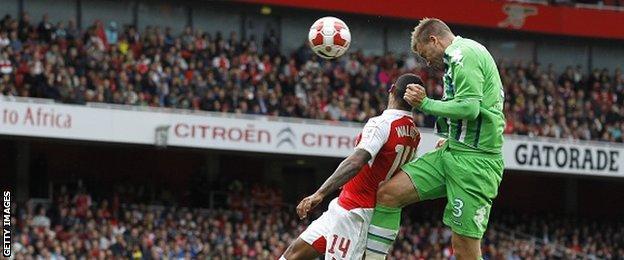 Former Arsenal striker Nicklas Bendtner in action for Wolfsburg against his old club
