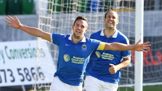 Andrew Waterworth celebrates after scoring one of his two goals for Linfield against Glenavon