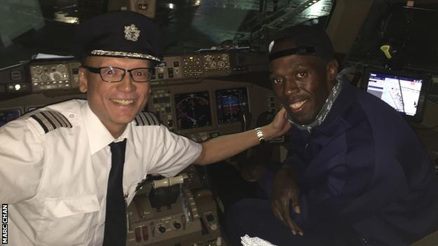 Pilot Marc Chan and Usain Bolt