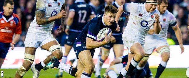 Huw Jones attacks for Scotland against England