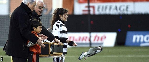 Doves are released before Lorient v PSG to honour victims of the Paris attacks