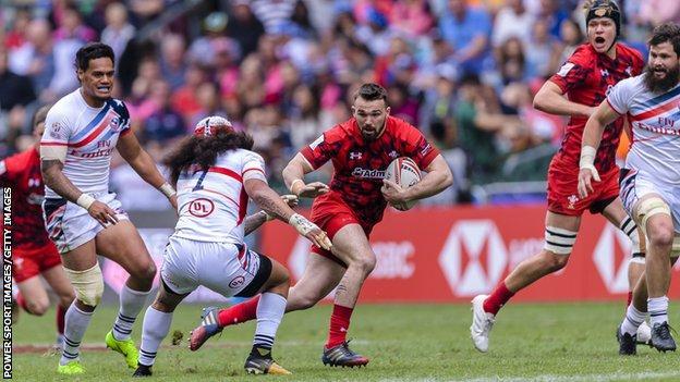 Afon Bagshaw runs with the ball during Hong Kong Sevens match between USA and Wales