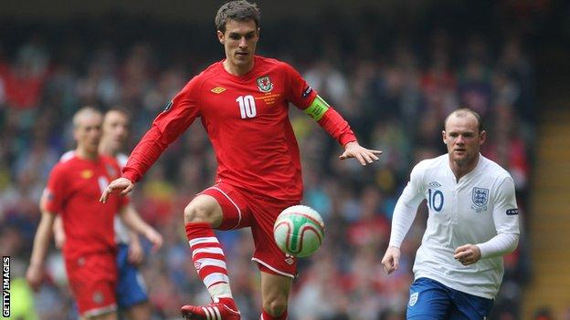 Wales midfield Aaron Ramsey in action against England in 2012