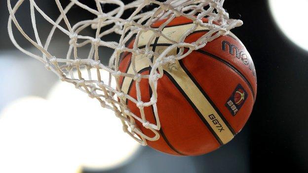 Basketball goes through a net