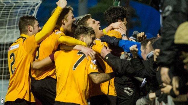 Annan players celebrate a famous Scottish Cup upset against Hamilton