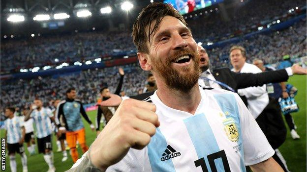 Lionel Messi punches the air to celebrate victory over Nigeria