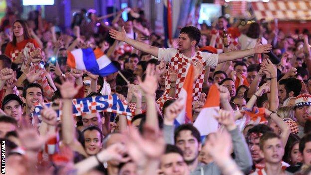 Croatia fans celebrate their semi-final victory over England on the streets of Zagreb