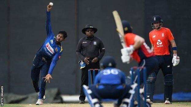 Sri Lanka's Kamindu Mendis bowls right-arm off-spin to England captain Eoin Morgan