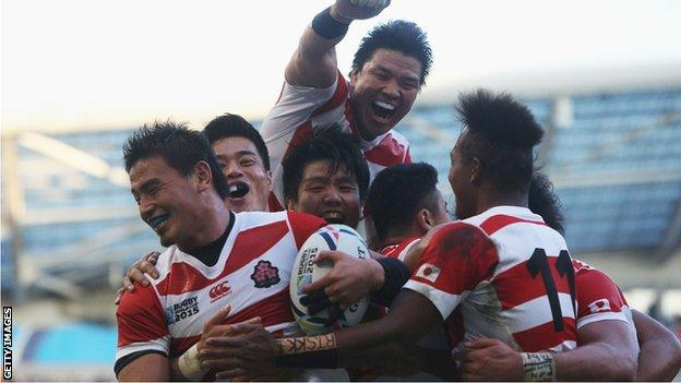 Japan celebrate beating South Africa