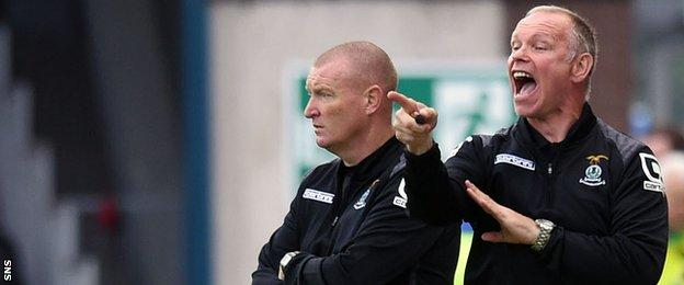 Inverness assistant Brian Rice and manager John Hughes