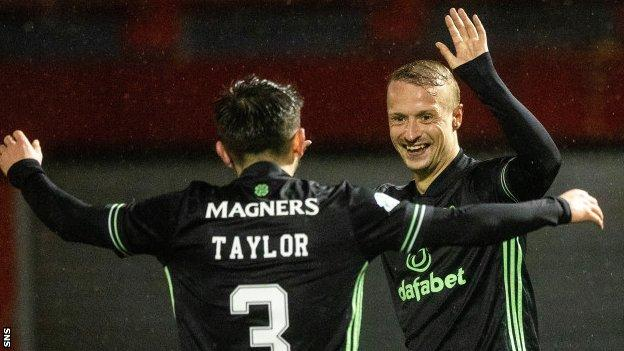 Celtic striker Leigh Griffiths (right) celebrates