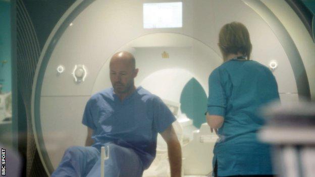 Alan Shearer exits the MRI scanner at the Queen Elizabeth University Hospital