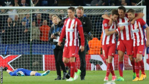 Atletico players celebrate in front of Jamie Vardy (laid out on the pitch)