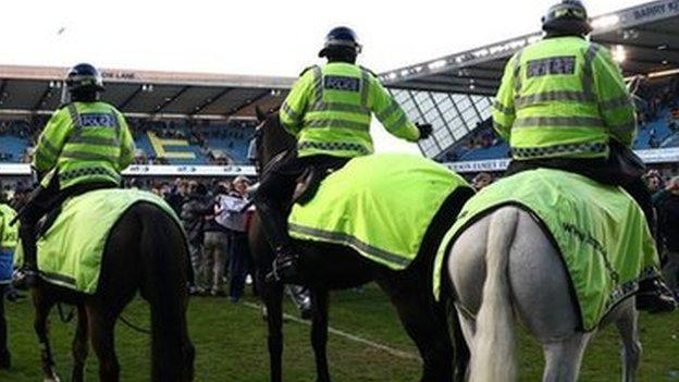 Millwall fans on the pitch following the club's 1-0 victory over Leicester City