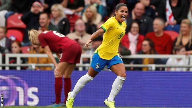 Debinha celebrates scoring for Brazil against England