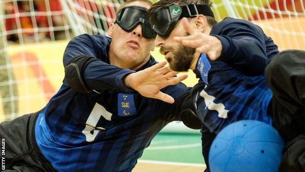 Jimmy Bjoerkstrand and Fatmir Seremeti block a ball from Brazil during their men's bronze-medal match of the Rio 2016 Paralympic Games.