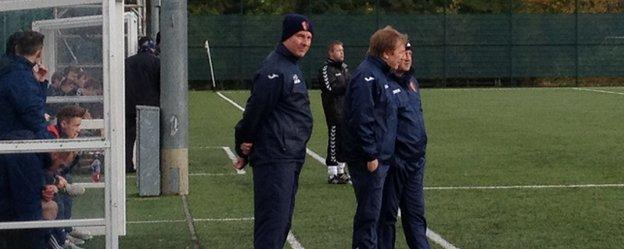 East Kilbride's management team - Billy Ogilvie and Gardner Speirs - chat on the sidelines