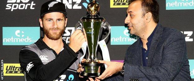 New Zealand captain Kane Williamson with the T20 series trophy