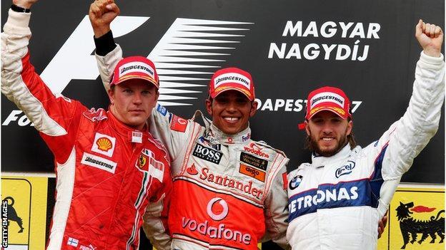Lewis Hamilton, Kimi Raikkonen and Nick Heidfeld