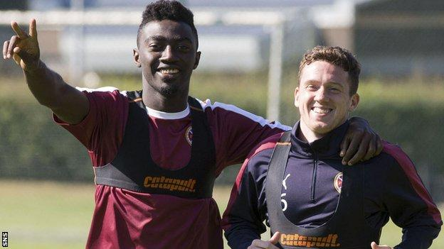 Hearts midfielders Prince Buaben and Danny Swanson