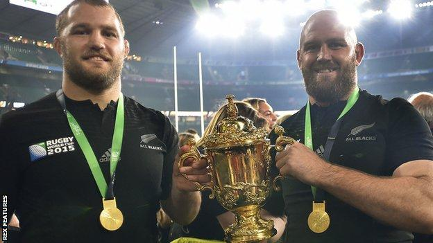 Ben Franks (right) holding the Rugby World Cup trophy with brother Owen