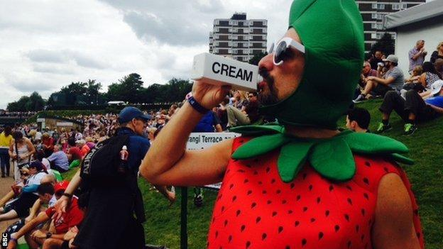 Spectator dressed as a strawberry