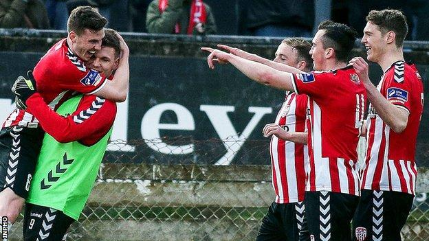 A delighted Harry Monaghan celebrates his goal against Rovers with Derry team-mates