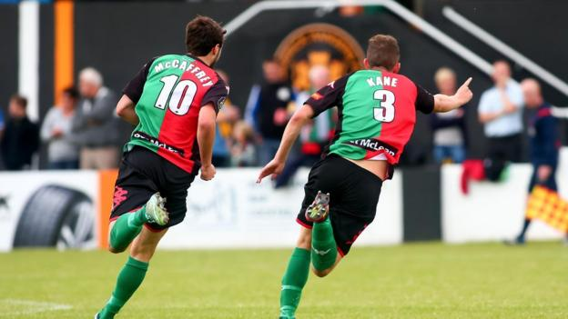 Fra McCaffrey goes in pursuit of Marcus Kane after the defender scored Glentoran's equaliser in their 1-1 draw at Carrick Rangers