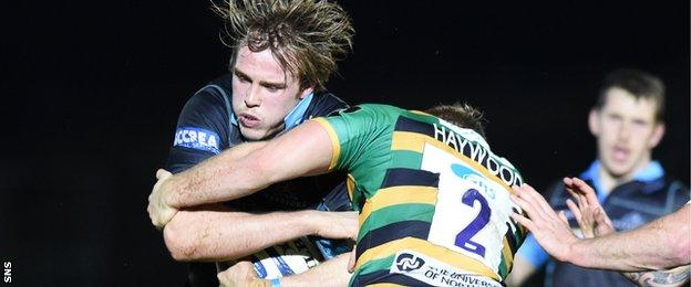 Jonny Gray is tackled by Mikey Haywood