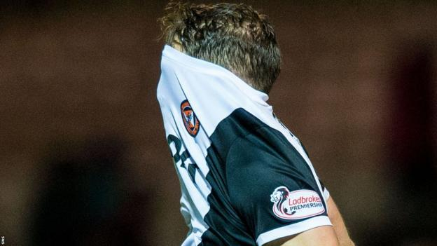 Dundee United midfielder John Rankin shows his disappointment