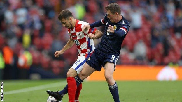 Josip Juranovic goes up against new Celtic teammate Callum McGregor at Euro 2020