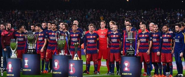 Barcelona's players lined up for a team photograph before kick-off with the five trophies the club won in 2015