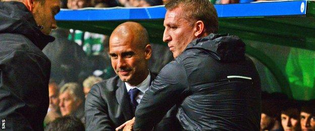 Manchester City's Pep Guardiola and Celtic's Brendan Rodgers shake hands