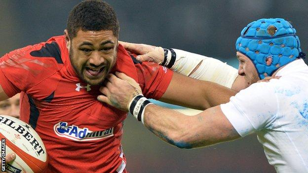 Taulupe Faletau takes on England's James Haskell in the 2015 Six Nations