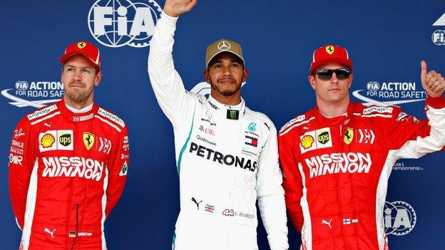 Ferrari's Sebastian Vettel and Kimi Raikkonen with Mercedes' Lewis Hamilton (centre)