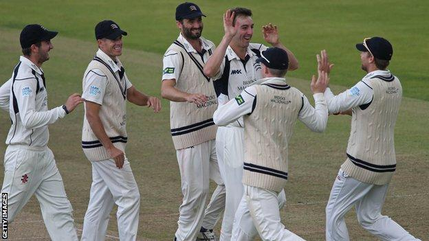 Toby Roland-Jones celebrates a wicket with Middlesex team-mates