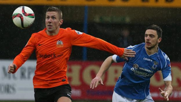 Glenavon's Daniel Kearns holds off Dale Montgomery in the Stangmore Park clash against Dungannon Swifts