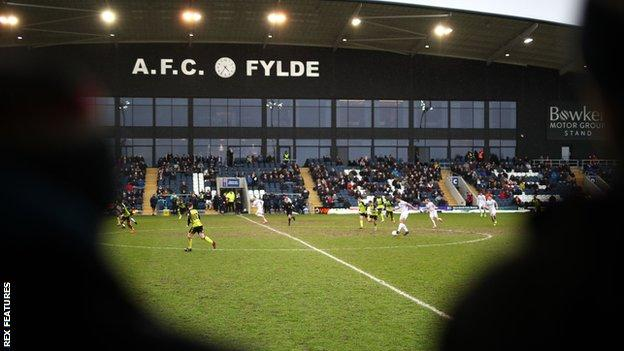Fans watch a match at AFC Fylde