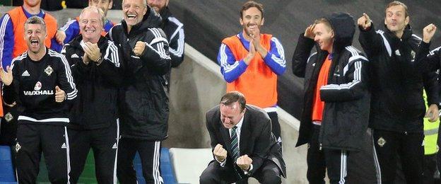 Michael O'Neill (crouching) celebrates