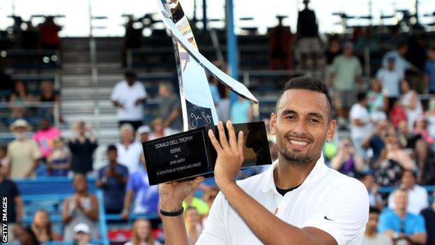 Nick Kyrgios lifts the Washington Open trophy after winning the ATP Tour 500 event last year