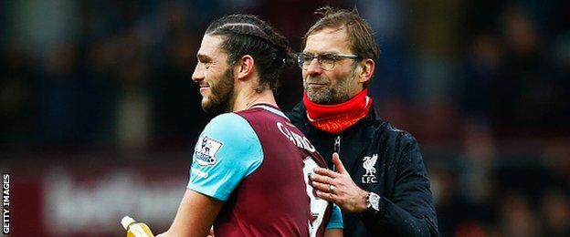 West Ham United striker Andy Carroll (left) with Liverpool manager Jurgen Klopp