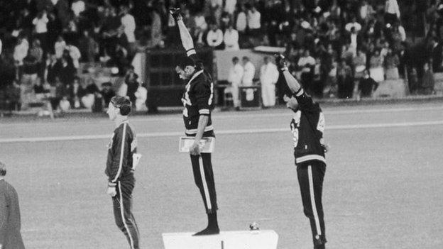 American track and field athletes Tommie Smith and John Carlos protest with the Black Power salute at the 1968 Olympics